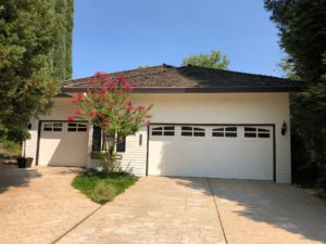 two car and single white carriage garage doors