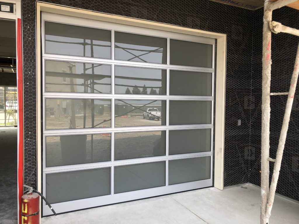 Full view frosted sectional garage door
