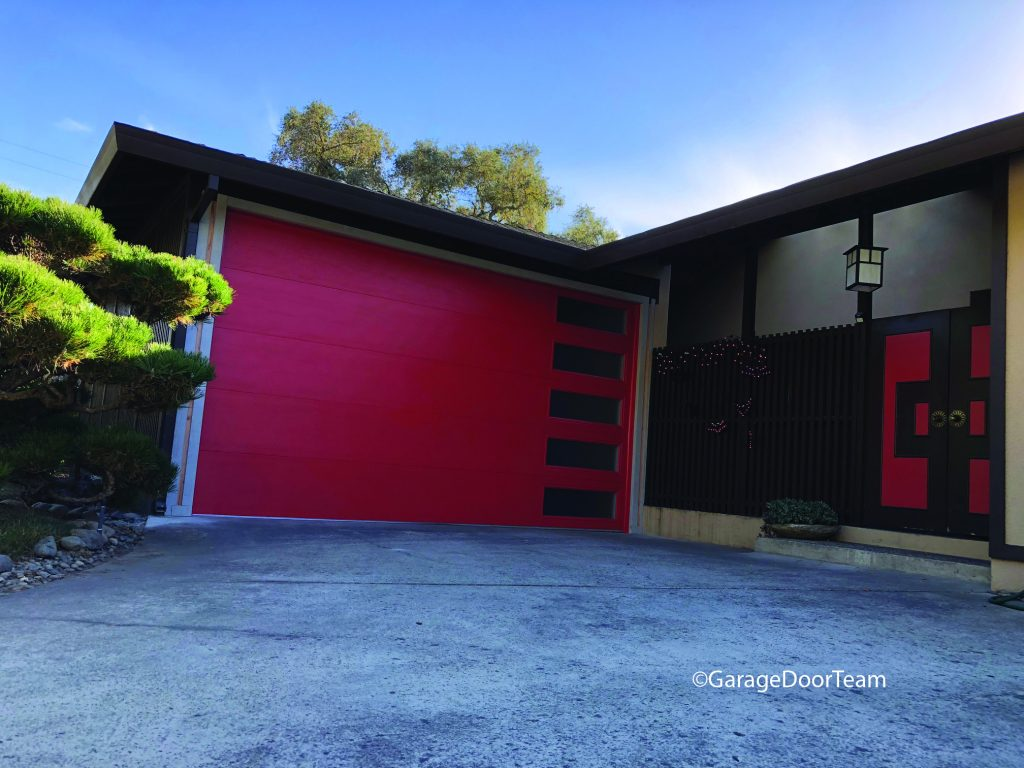 Red custom garage door side vertical windows